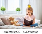 Cute little child girl reading...