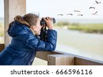 young girl bird watching | Shutterstock . vector #666596116