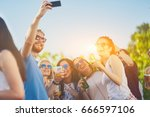 friends taking selfie at party... | Shutterstock . vector #666597106