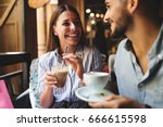 Stock photo young attractive couple on date in coffee shop 666615598