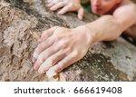 Young Man Climbing On Rock Wal...