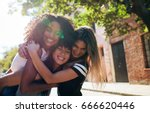 three happy young women...   Shutterstock . vector #666620446