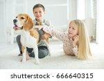 children with a dog | Shutterstock . vector #666640315