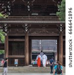 Small photo of TOKYO, JAPAN - 25TH JUNE 2017. Shinto priest at Meiji Jingu temple grounds. Meiji Jingu is a Shinto shrine dedicated to the deified spirits of Emperor Meiji and his spouse.