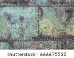 old metal door on rivets | Shutterstock . vector #666675532