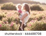 woman holding baby girl 3 4... | Shutterstock . vector #666688708
