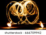 fire show and a lot of the... | Shutterstock . vector #666709942