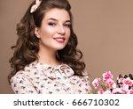 fresh young girl in a light... | Shutterstock . vector #666710302