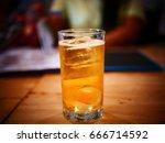 drinking beer in a restaurant | Shutterstock . vector #666714592