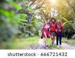 group of young people hikers in ... | Shutterstock . vector #666721432