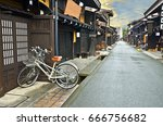 two bicycle in old town area of ... | Shutterstock . vector #666756682