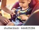 protection in the car. hands of ... | Shutterstock . vector #666825286