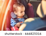 adorable baby in safety car... | Shutterstock . vector #666825316