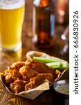 pile of tasty buffalo chicken... | Shutterstock . vector #666830926