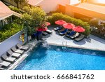 swimming pool with red umbrella ... | Shutterstock . vector #666841762