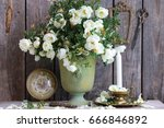Stock photo white dog roses in vintage green color metal old vase planter antique bronze frame scissors on 666846892