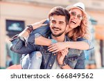 happy young couple having fun... | Shutterstock . vector #666849562