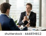 attentive businessman listening ... | Shutterstock . vector #666854812
