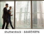 busy businesspeople in office... | Shutterstock . vector #666854896