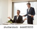 male employee meditating at... | Shutterstock . vector #666855055