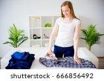 happy mother ironinglaundry | Shutterstock . vector #666856492