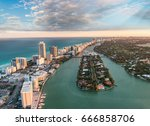 miami beach aerial view at dusk ... | Shutterstock . vector #666858706