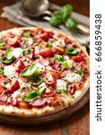 rustic pizza with mozzarella ... | Shutterstock . vector #666859438