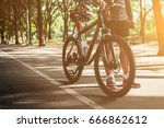 men with bikes on street in the ... | Shutterstock . vector #666862612