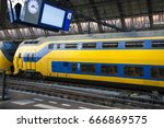 dutch train on the railway... | Shutterstock . vector #666869575