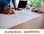 hands of engineer working on... | Shutterstock . vector #666895456