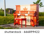 Small photo of London, Ontario, Canada-June 3 2017: The Hyde Park outdoor Piano painted by the students of Oakridge school in the theme of our Canadian 150 year celebration. The piano is left outside for the summer.