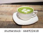 hot green tea latte in a... | Shutterstock . vector #666922618