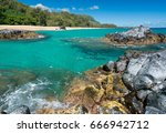 rocks frame the turquoise ocean ... | Shutterstock . vector #666942712