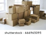 stack of brown mockup boxes for ... | Shutterstock . vector #666965095
