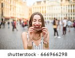 young and happy woman with dark ... | Shutterstock . vector #666966298