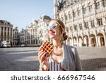 young woman walking with waffle ... | Shutterstock . vector #666967546