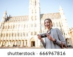young female tourist standing... | Shutterstock . vector #666967816