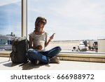 young woman in the airport ... | Shutterstock . vector #666988972