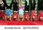 Sporty Kids Making Handstand...