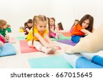 diligent girl doing stretching... | Shutterstock . vector #667015645