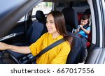 wide shot of female driving car ... | Shutterstock . vector #667017556