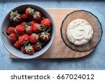 stawberry with sweet sauce | Shutterstock . vector #667024012