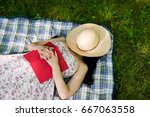 woman sleeping in the grass... | Shutterstock . vector #667063558