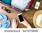 woman hand holding smartphone... | Shutterstock . vector #667073848
