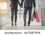 couple in love holding shopping