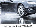 Sports Car Driven On Rainy...