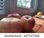 apples on the windowsill. near... | Shutterstock . vector #667127482