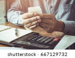 business man or accountant... | Shutterstock . vector #667129732