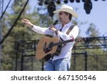 "Small photo of Santa Rosa, CA/USA: 6/16/17: William Michael Morgan performs at Country Summer festival. His debut single ""I Met a Girl"", hit #2 on the Country Airplay chart and #8 on the Hot Country Songs chart."
