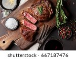 grilled ribeye beef steak with... | Shutterstock . vector #667187476